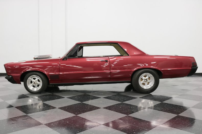 1965 Wineberry metallic Pontiac Le Mans Pro Street Hardtop with Parchment interior