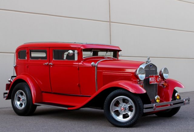 1929 Red Ford Model A 4 door Sedan with Red interior