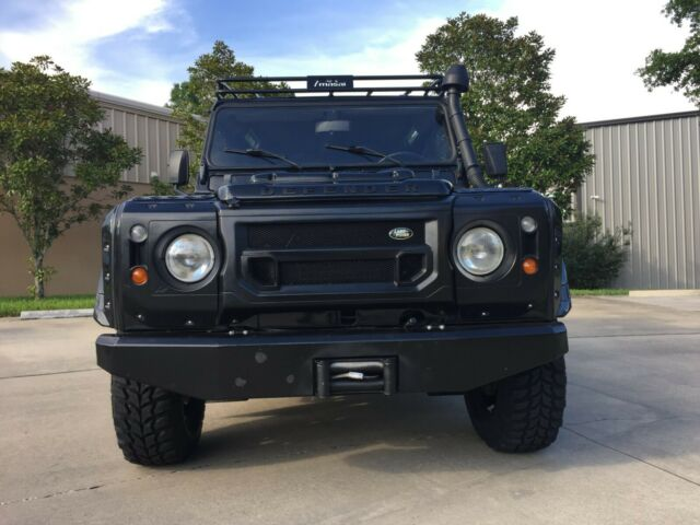 1987 Black Land Rover Defender with Black & Red interior