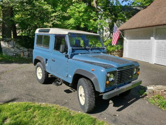 1991 Blue Land Rover Defender with Gray interior