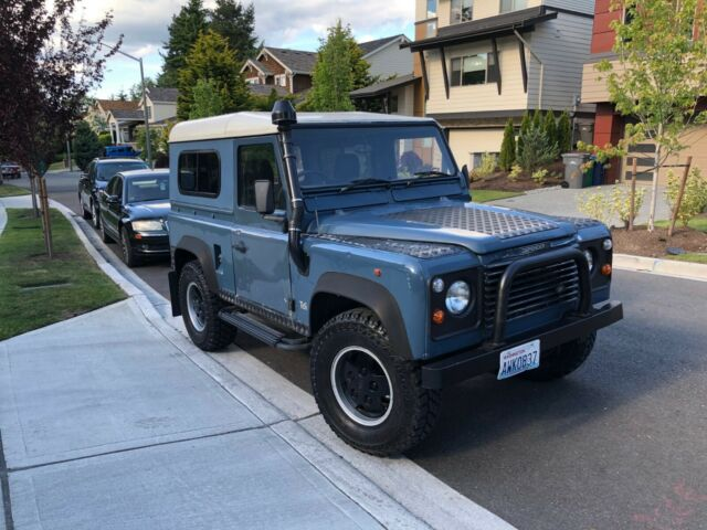 1986 Blue Land Rover Defender SUV with Black interior