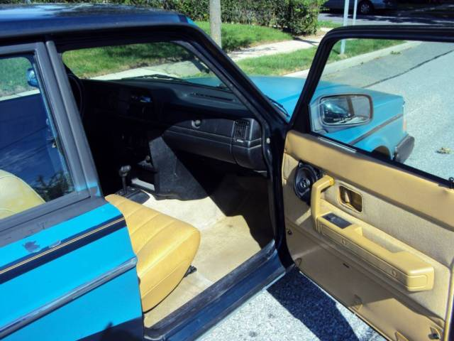 1993 Green Volvo 240 Wagon with Gold interior