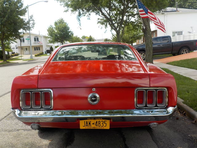 1970 Red Ford Mustang Fastback with Black interior