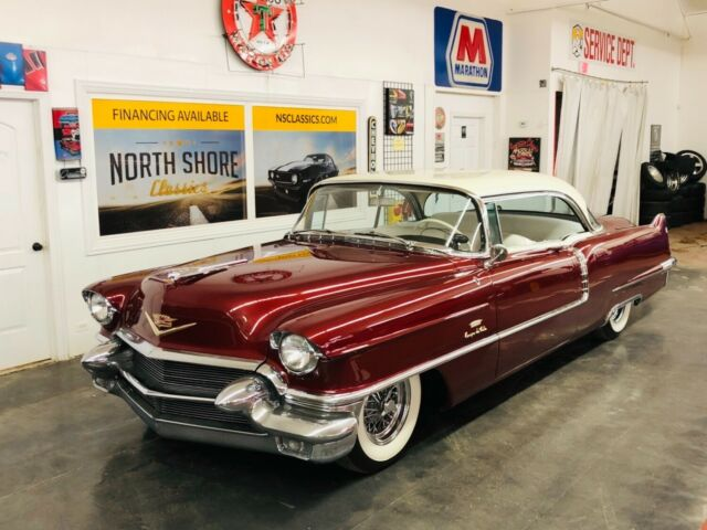 Matador Red Cadillac Coupe DeVille with 5,000 Miles available now!