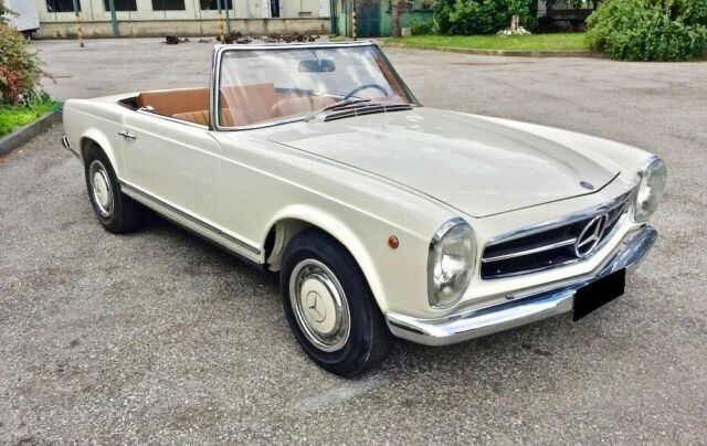 1967 White Mercedes-Benz SL-Class Convertible with Brown interior
