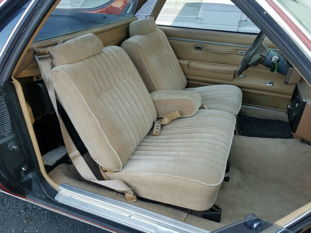 1986 copper red Chevrolet El Camino auto/pickup with tan interior