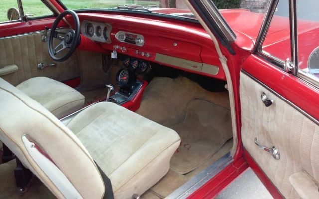 1965 Red Chevrolet Nova SS Hard Top with Tan interior