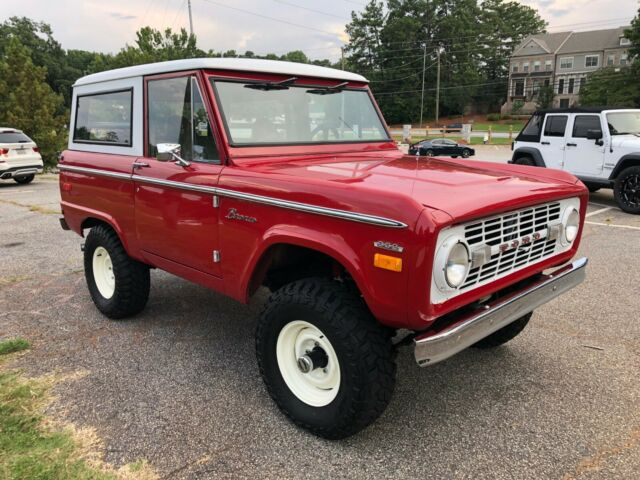 1970 Red Ford Bronco SUV with Tan interior