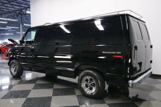 1976 Black Ford E-Series Van Chateau Van with Blue interior