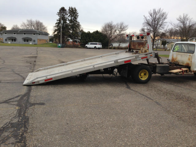 Rollback tow truck flatbed new engine towtruck jerrdan for Truck motors for sale