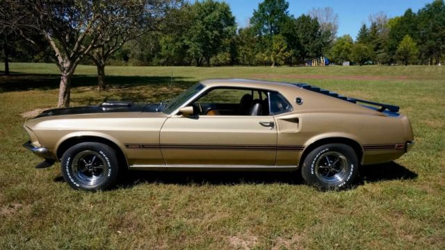 "1969 Gold Ford Mustang MACH1 ""R"" CODE 428 COBRA JET Coupe with Black interior"