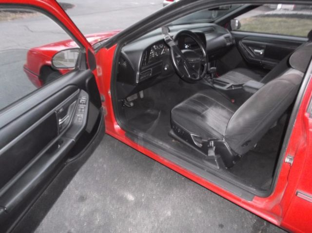 1991 Red Ford Thunderbird Coupe with Gray interior