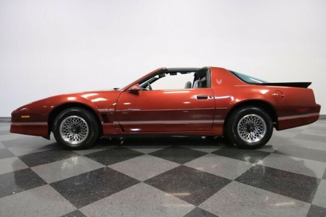 1986 Burgundy Pontiac Firebird Trans Am Coupe with Gray interior
