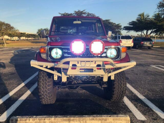 1993 Red Toyota Land Cruiser SUV with Brown interior