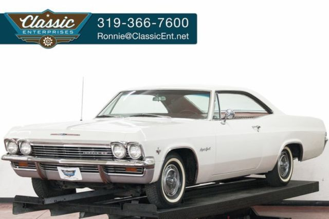 1965 Chevrolet Impala muscle car with 4 speed power steering solid frame