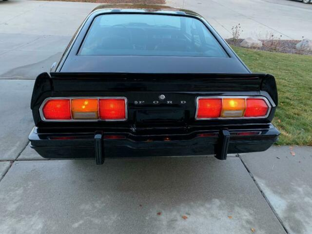 1976 Black Ford Mustang Cobra II Coupe with Black interior