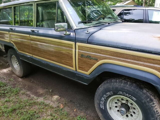 1990 Blue Jeep Wagoneer Wagon with Tan interior